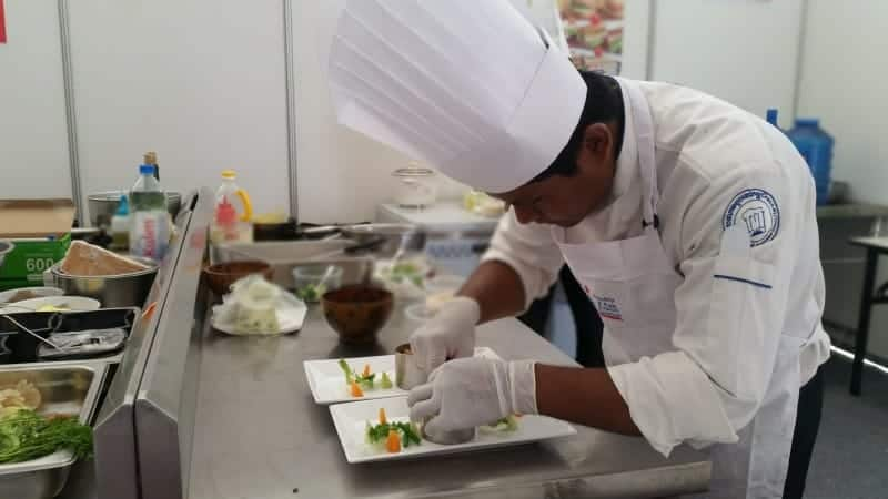 Chef Sovandam preparing his award-wining main course menu