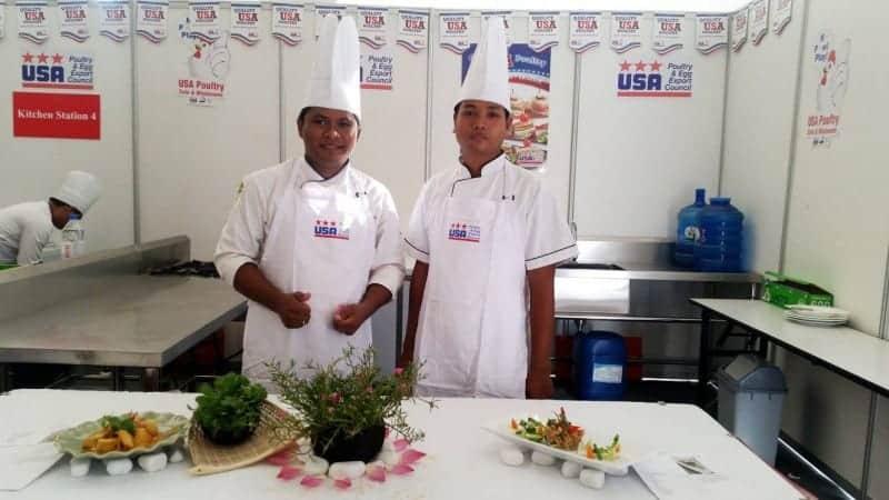 Chef Sovandam and Mr. Savath pose after preparing their award-winning main course menu.